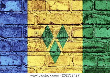 Saint Vincent and the Grenadines flag painted on the brick wall