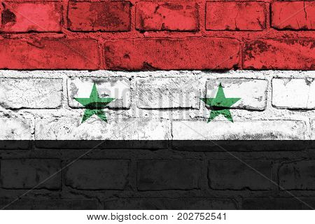 Syria flag painted on the brick wall