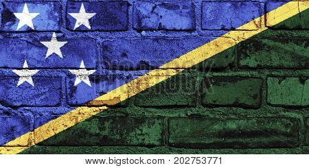 The Solomon Islands flag painted on the brick wall