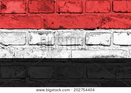 Yemen flag painted on the brick wall
