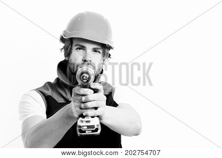 Construction Worker Holds Yellow Drill As Gun. Builder With Drill