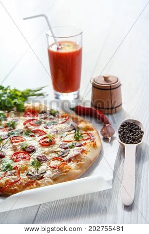 Fresh Homemade Pizza With Tomatoes, Salami, Cheese And Mushrooms On Piece Of Baking Paper