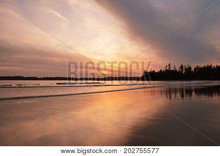 Twilight setting on the beaches of Tofino BC.