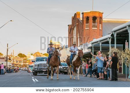 Charters Towers Australia - April 28 2017: Robbie Gough and Bob Katter lead the 40th Country Music Parade in historic Charters Towers Queensland Australia