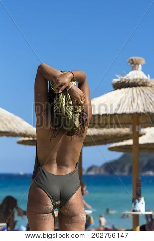 Rear View of Sexy Woman Standing on Beach