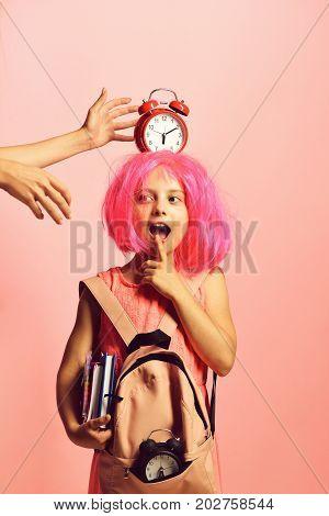 Back To School Concept. Schoolgirl With Red Alarm On Head