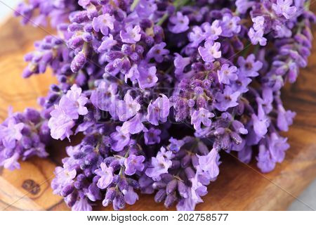 Bouquet of lavender on a wooden background.