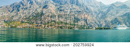 Panorama of Kotor Bay with a fragment of the ancient city of Kotor, Montenegro. A view of the mountains from the waters of the Bay of Kotor on the Adriatic Sea.