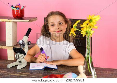 Study Room And Beauty Concept. Schoolgirl At Her Desk