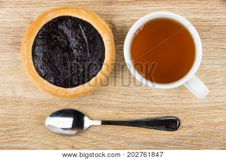 Pie With Blueberry Jam, Cup Of Tea And Teaspoon
