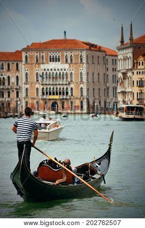 Gondola in canal in Venice, Italy.