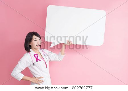 woman doctor take speech bublle with breast cancer prevent concept on pink background