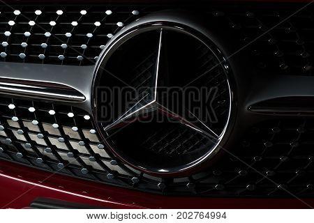 BANGKOK, THAILAND - AUGUST, 30 2017: Closeup of Mercedes Benz logo on red Mercedes Benz CLA 250 2017 model