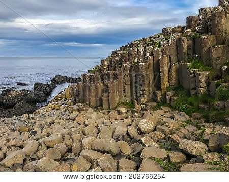 Beautiful scenery with basalt columns sticking out of the ground at Giants Causeway in Northern Ireland in the county of Antrim in the United Kingdom Europe