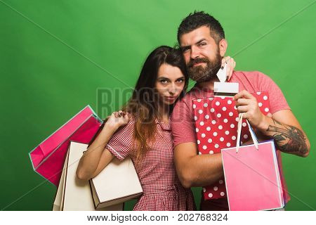 Shopping And Fashion Concept. Bearded Man Holds Shopping Bag