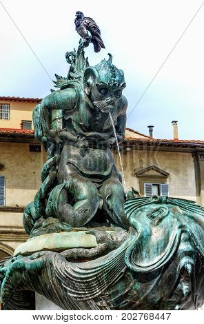 FLORENCE, ITALY-MARCH 24, 2017: Fountain (Renaissance sculptor Pietro Tacca) in Piazza Santissima Annunziata, Florence