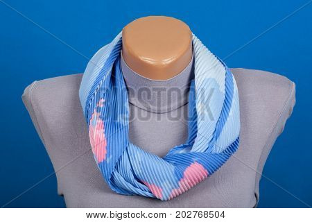 Blue Scarf On Mannequin Isolated On Blue Background.