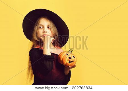 Kid In Black Witch Hat, Dress And Sly Face