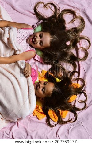 Morning Time And Childhood Concept. Schoolgirls In Pink Pajamas