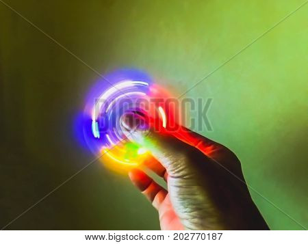Light burry colorful spinning light on hand