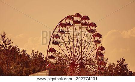 Amusement park sunset. Ferris Wheel Over Blue Sky. the Amusement park