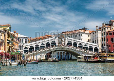 Venice, Italy - May 18, 2017: The old Rialto Bridge over the Grand Canal. Rialto Bridge (Ponte di Rialto) is one of the main tourist attractions of Venice.