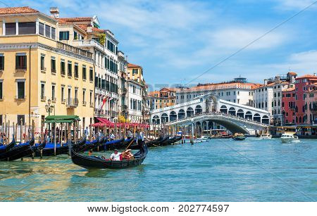 Venice, Italy - May 18, 2017: Grand Canal with the Rialto Bridge. Grand Canal is one of the major water-traffic corridors and tourist attraction in Venice.