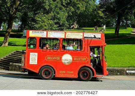 Buxton Derbyshire England UK Europe - August 28 2017 : Buxton tour bus taking tourists around the tourist attractions