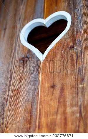 Wooden fence with heart. Part of a window in Tirol, Austria.