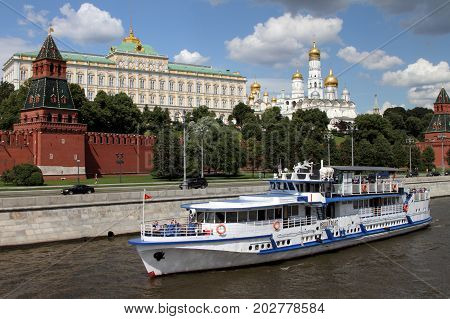 Moscow Russia - July 20 2017: Pleasure boat sails along the river near the Moscow Kremlin.