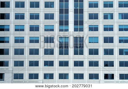 close up on facade view of glass windows in office building