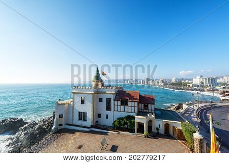 Wide angle view of Wulff Castle with the Pacific Ocean and Vina del Mar Chile in the background