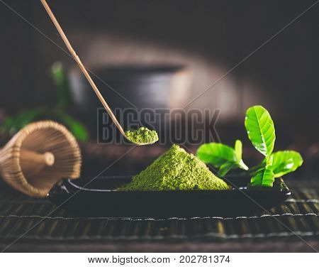 Matcha. Organic Green Matcha Tea ceremony. Matcha powder. Cooking with matcha, recipe. Vegetarian healthy drink, beverage, Japanese food. Dark still life