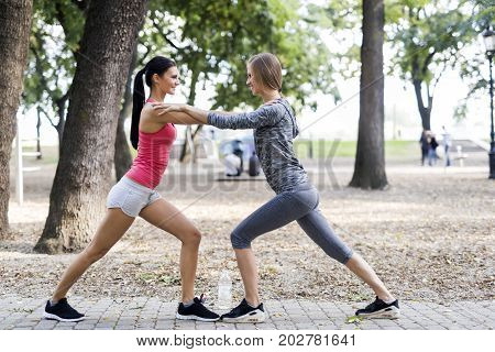 Beautiful women streching outdoors before setting off for their run
