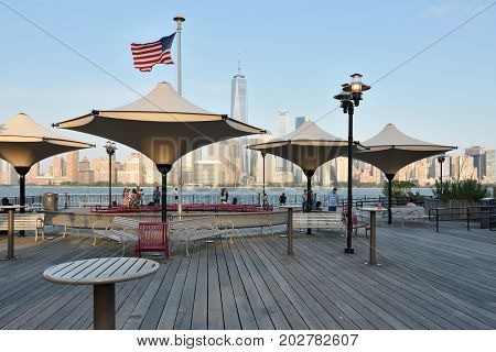 JERSEY CITY NJ - AUGUST 23: View of Manhattan New York City on August 23 2017. Manhattan is often described as the cultural financial media and entertainment capital of the world.