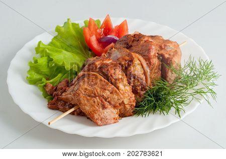 Beef Pork Barbecue Kebab On Skewer On A White Plate