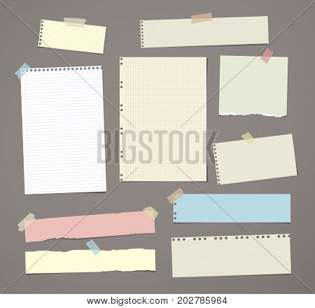 White and colorful striped note paper, copybook, notebook sheet stuck with adhesive tape on dark brown background
