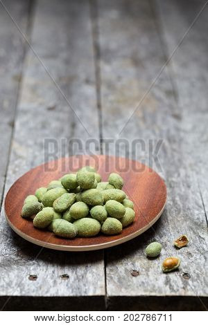 Wasabi peanuts on rustic wooden background picture