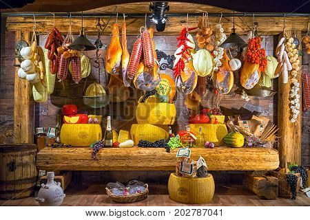 Kotor Montenegro - September 04 2017: storefront of Cogimar shop a famous fish store in Montenegro. The showcase is decorated with an abundance of products - cheese sausages jamon fruit wine.