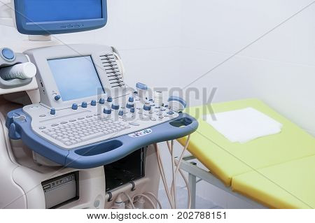 Close Up Part Of Ultrasonography Machine And Bed In Hospital. Selective Focus
