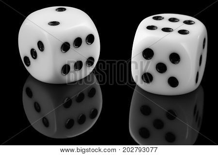 White Dice On Black Background with reflection close up.
