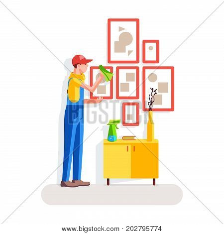 Cleaning of offices. The worker wipes the dust off the pictures on the background of the interior. Vector illustration in a flat style.