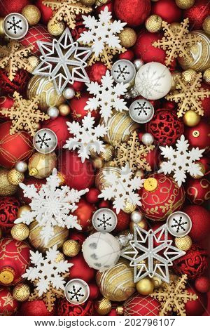 Snowflake, bell and christmas bauble decorations forming an abstract background.