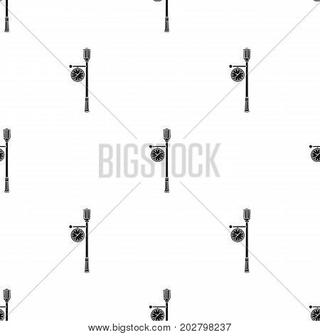 Lamppost with a clock.Lamppost single icon in black style vector symbol stock illustration .