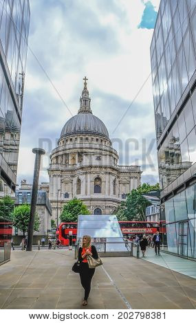 St. Paul's London UK - August 3 2017: Looking at St. Paul's Cathedral from 1 New Change. Shows The Nail sculture and shoppers.