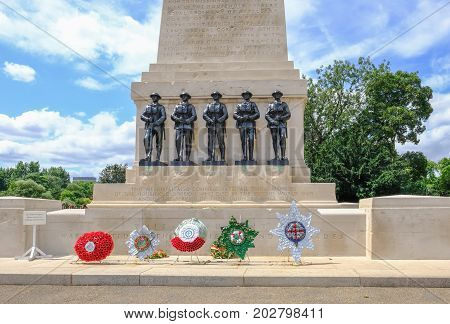St. James London UK - July 21 2017: Memorial to the First World War. Close up shot showing the statues of soldiers and wreaths placed on the step.