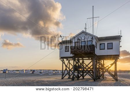 Wooden house on stilts on the beach at Sankt Peter Ording, Germany