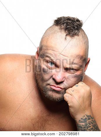 Angry, aggressive, bearded man with mohawk isolated on a white background.