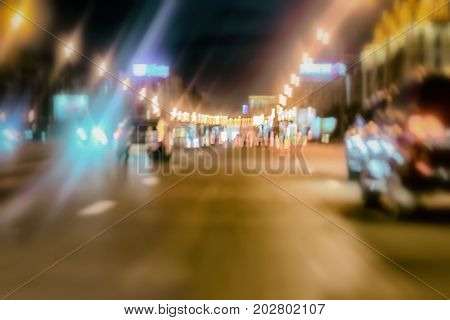 Abstract blurred colorful background of urban street night traffic with bokeh lights. Auto, city street lights and speed. Selective focus. Traffic through the city at night