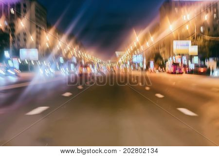 Abstract blurred colorful background of urban street night traffic with bokeh lights, city street lights. Selective focus. Copy space for text